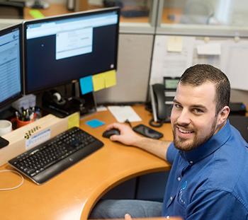 A Conexus team member working at an office desk