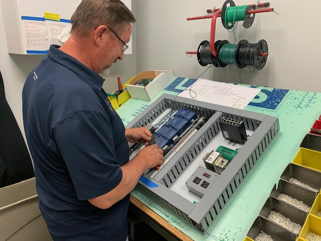 A Conexus employee working on BACnet master slave token passing
